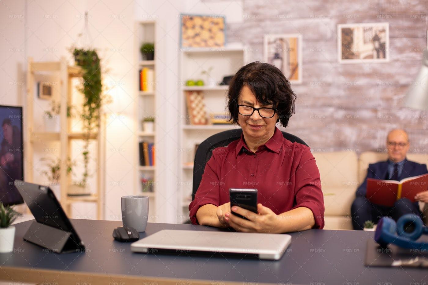 Aged Woman Browsing Phone: Stock Photos