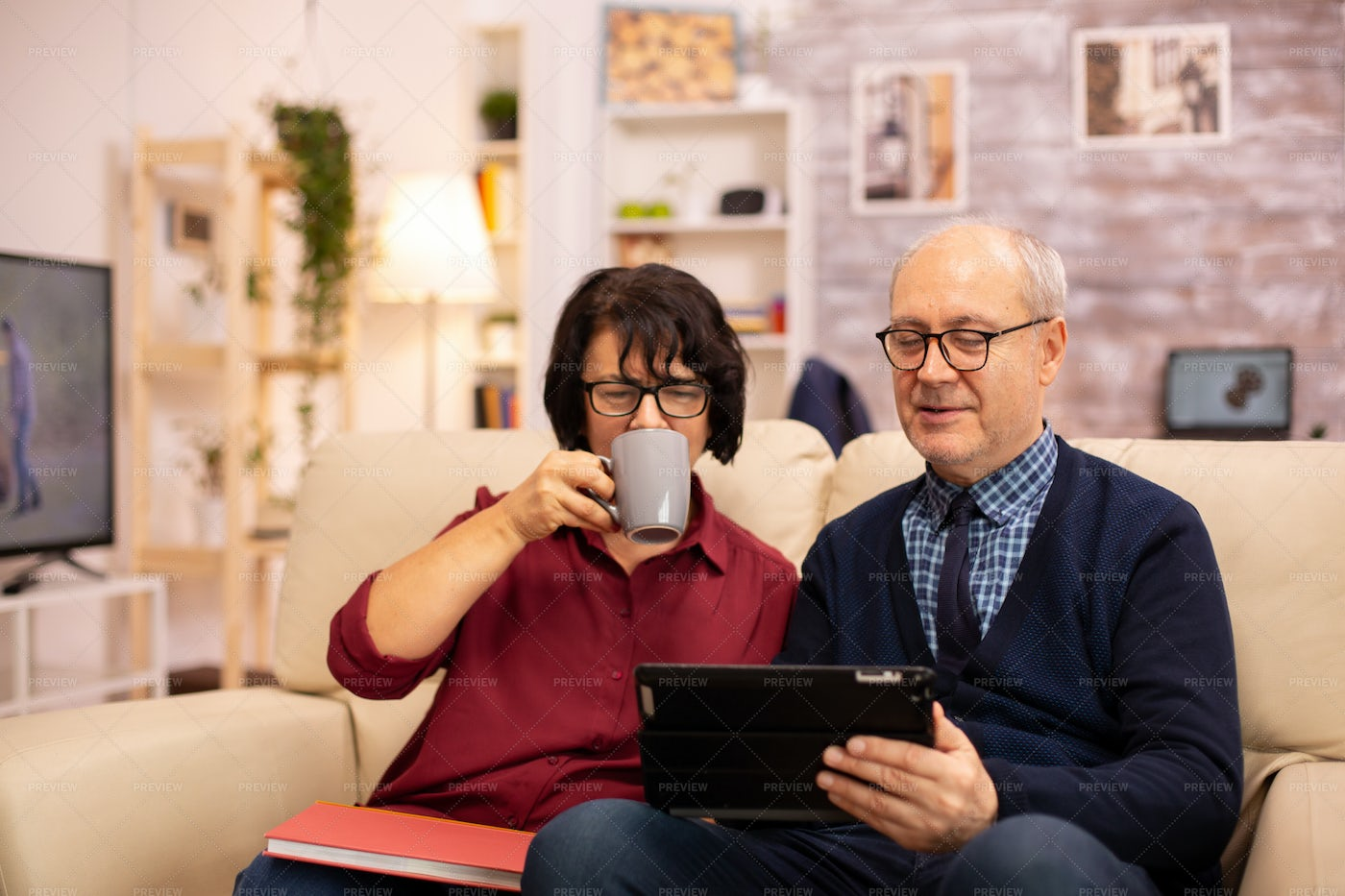 Beautiful Old Couple Using A Tablet: Stock Photos