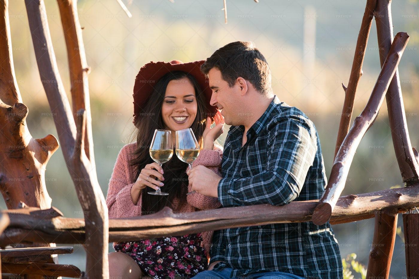 Couple Sitting On A Wooden Pontont: Stock Photos