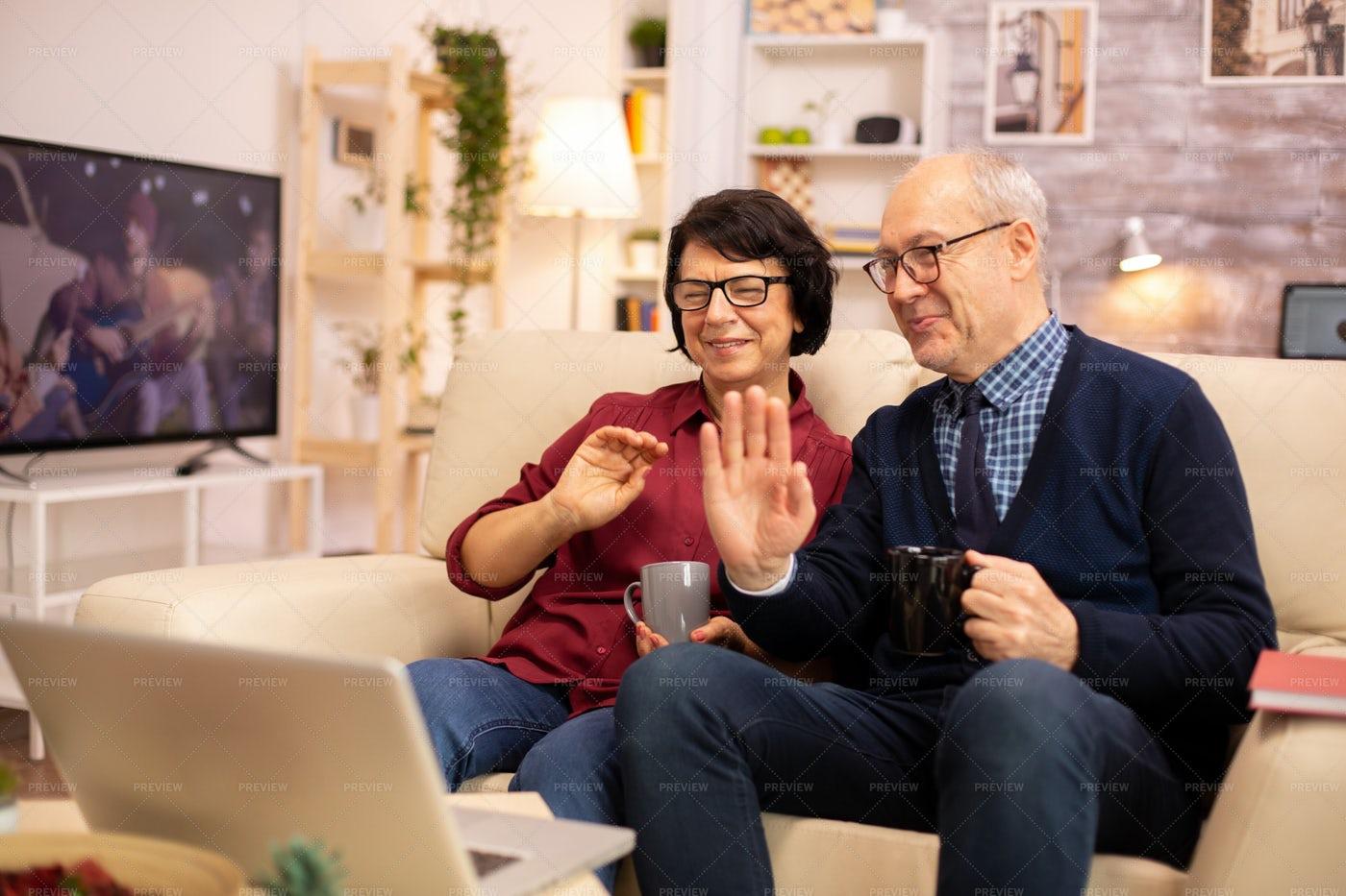 Couple Waving On Video Call: Stock Photos