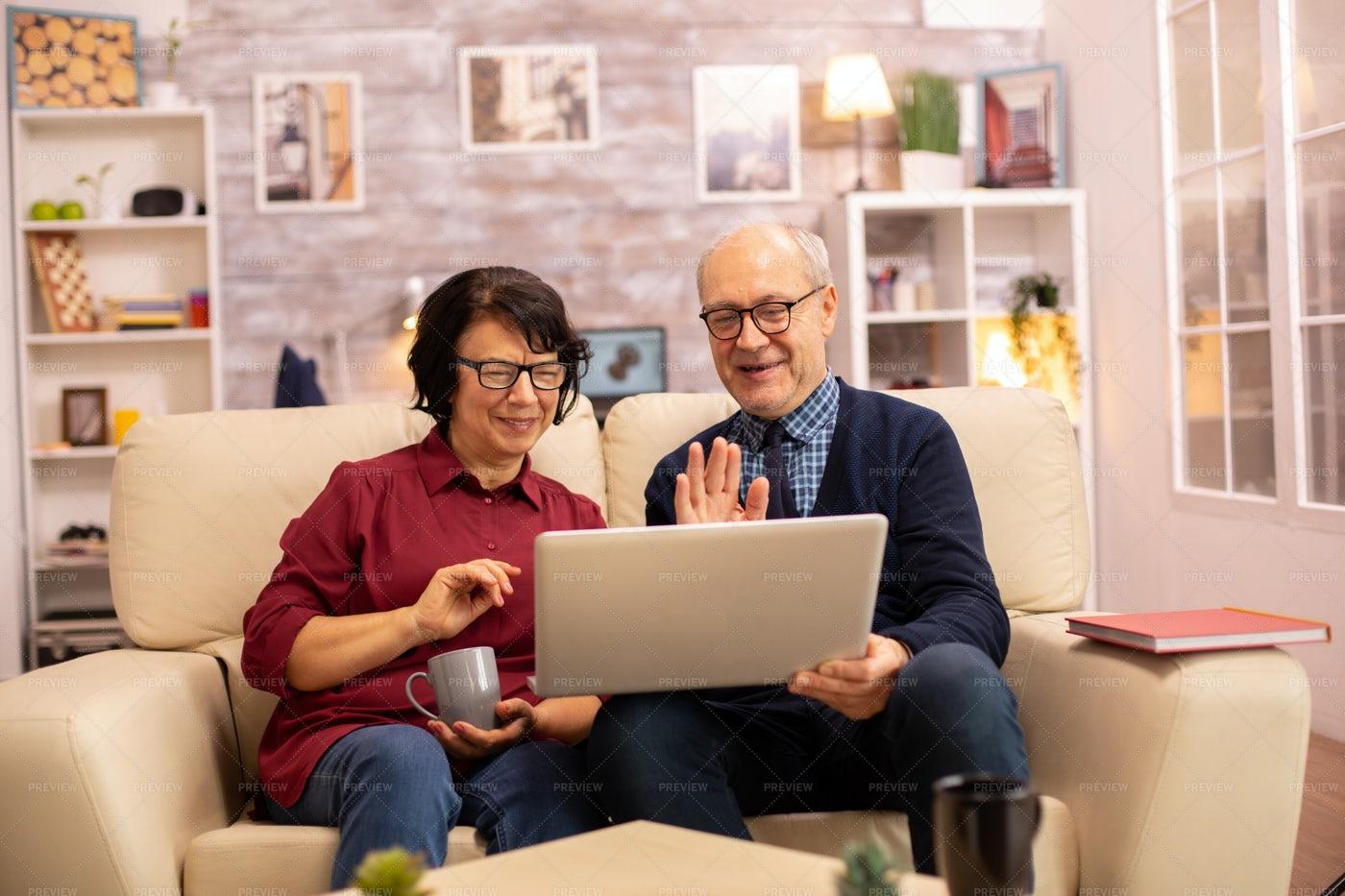 Elderly Couple Wave On Video Call: Stock Photos