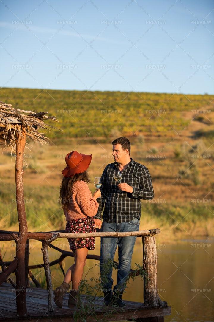 Couple Enjoying A Glass Of Wine: Stock Photos