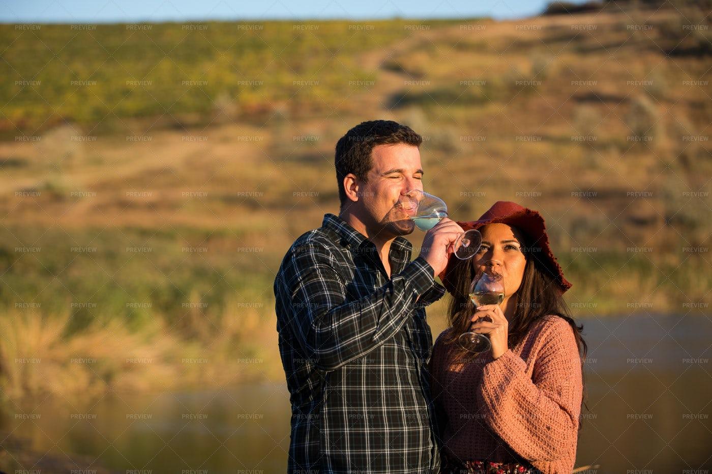 Drinking Wine On Vineyard Lake: Stock Photos