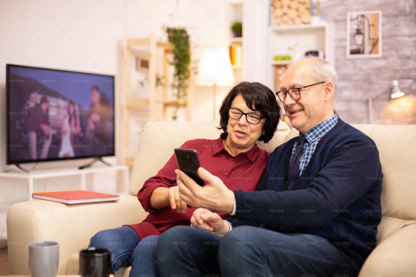 Elderly Couple Using A Smartphone: Stock Photos