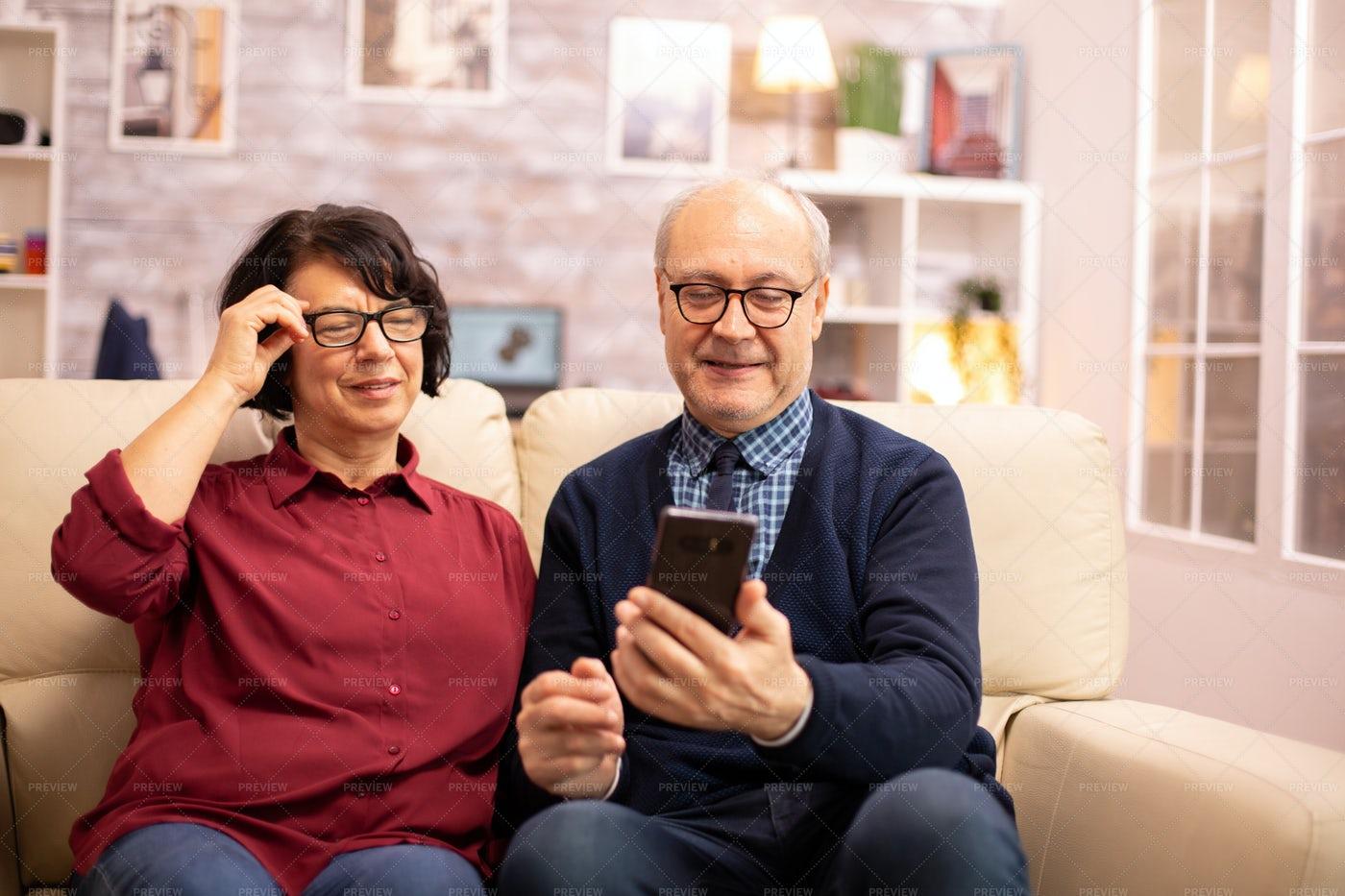 Needing Glasses To See  Phone Screen: Stock Photos