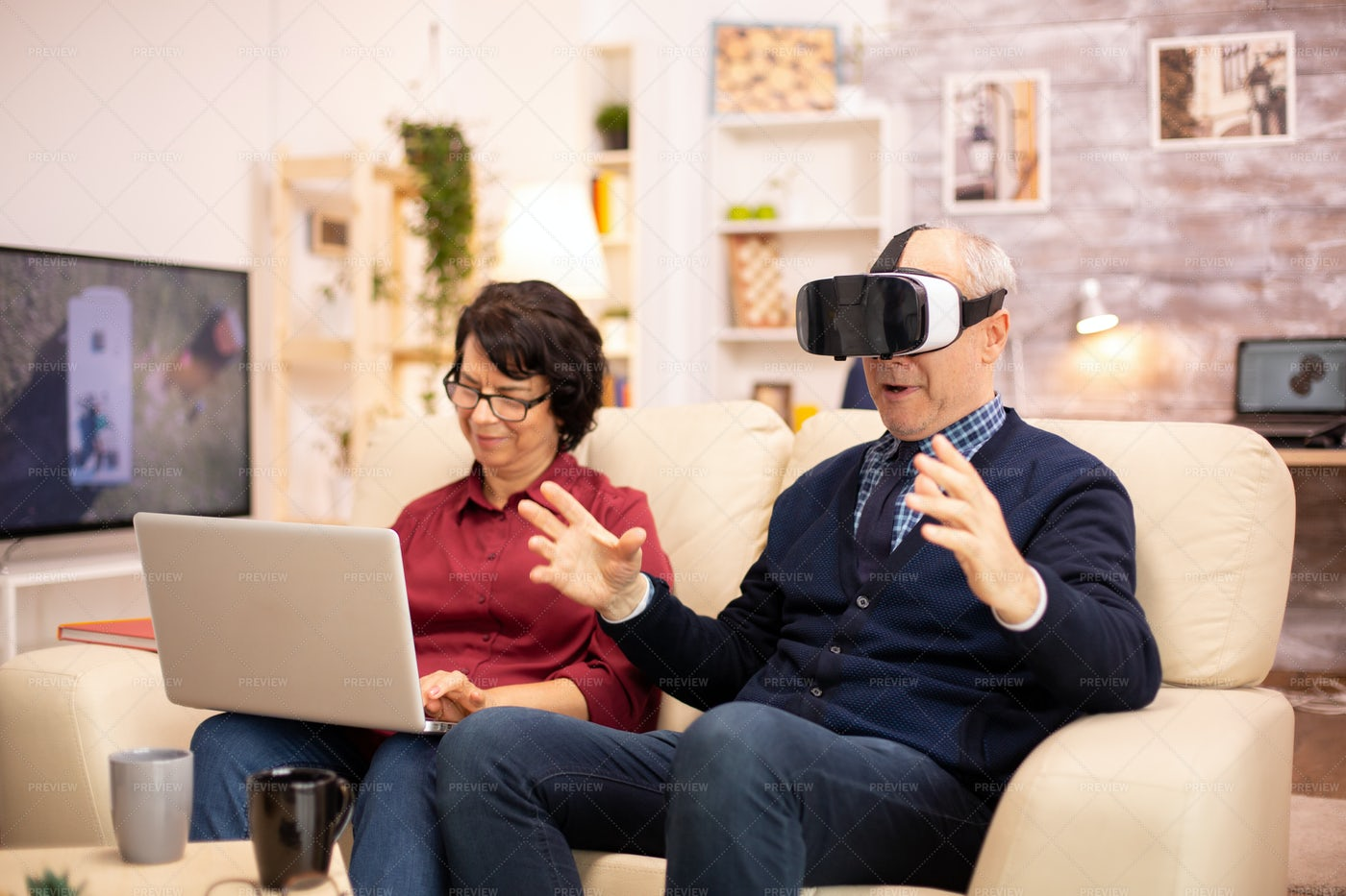 Old Couple Using Modern Technology: Stock Photos
