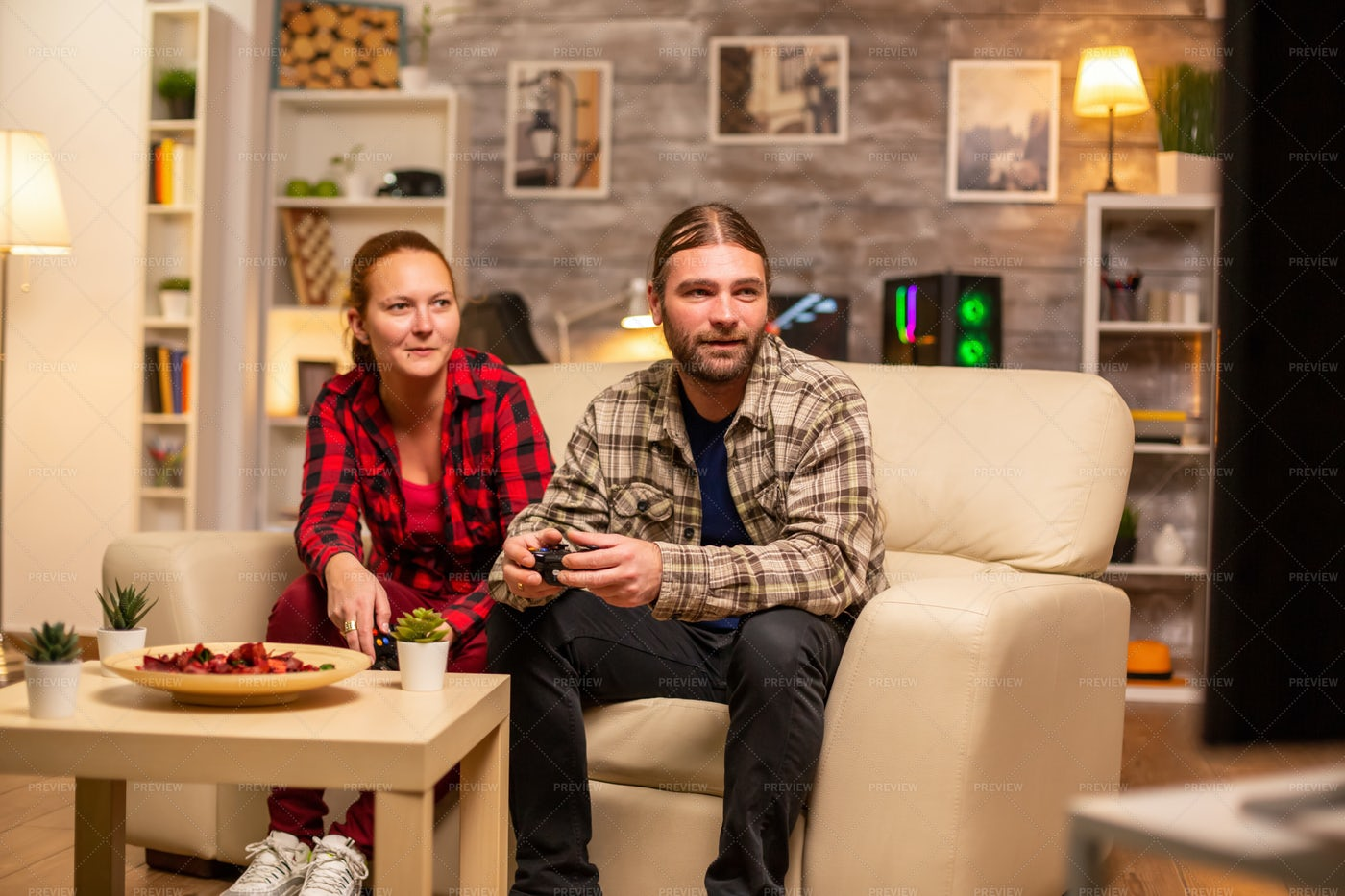 Gamers Couple Playing Video Games: Stock Photos