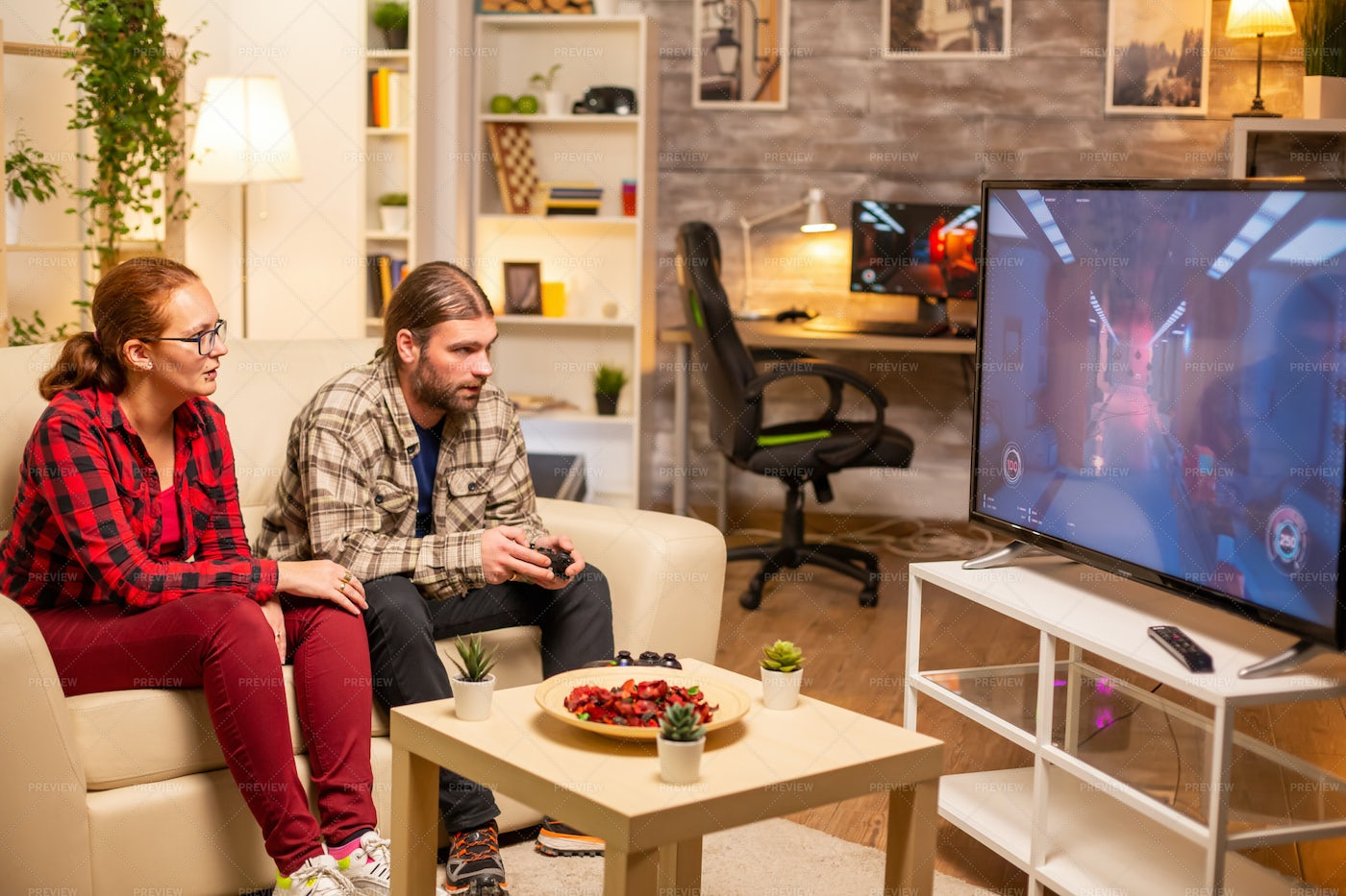 Playing Video Games On Couch: Stock Photos