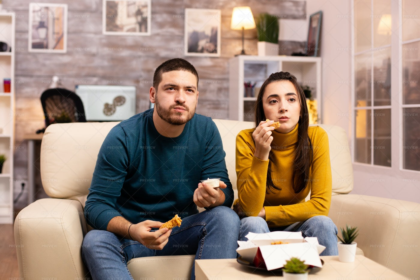 Young Couple Eating Fried Chicken: Stock Photos