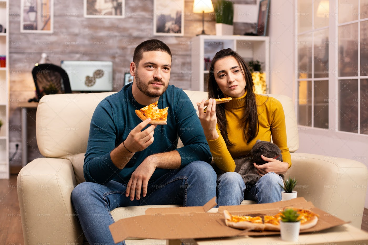 Couple Eating Pizza: Stock Photos