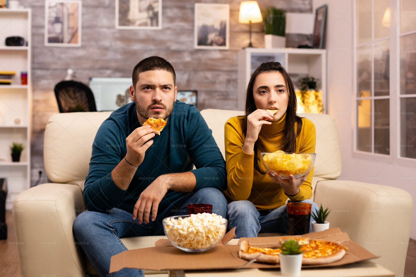 Young Couple Watching TV: Stock Photos
