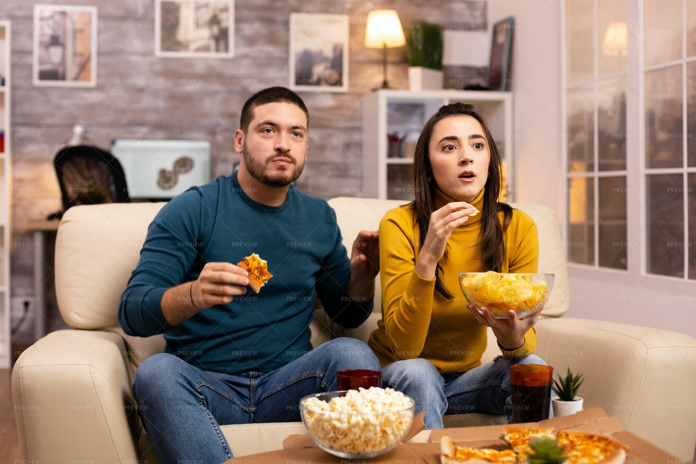 Watching A Horror Movie: Stock Photos