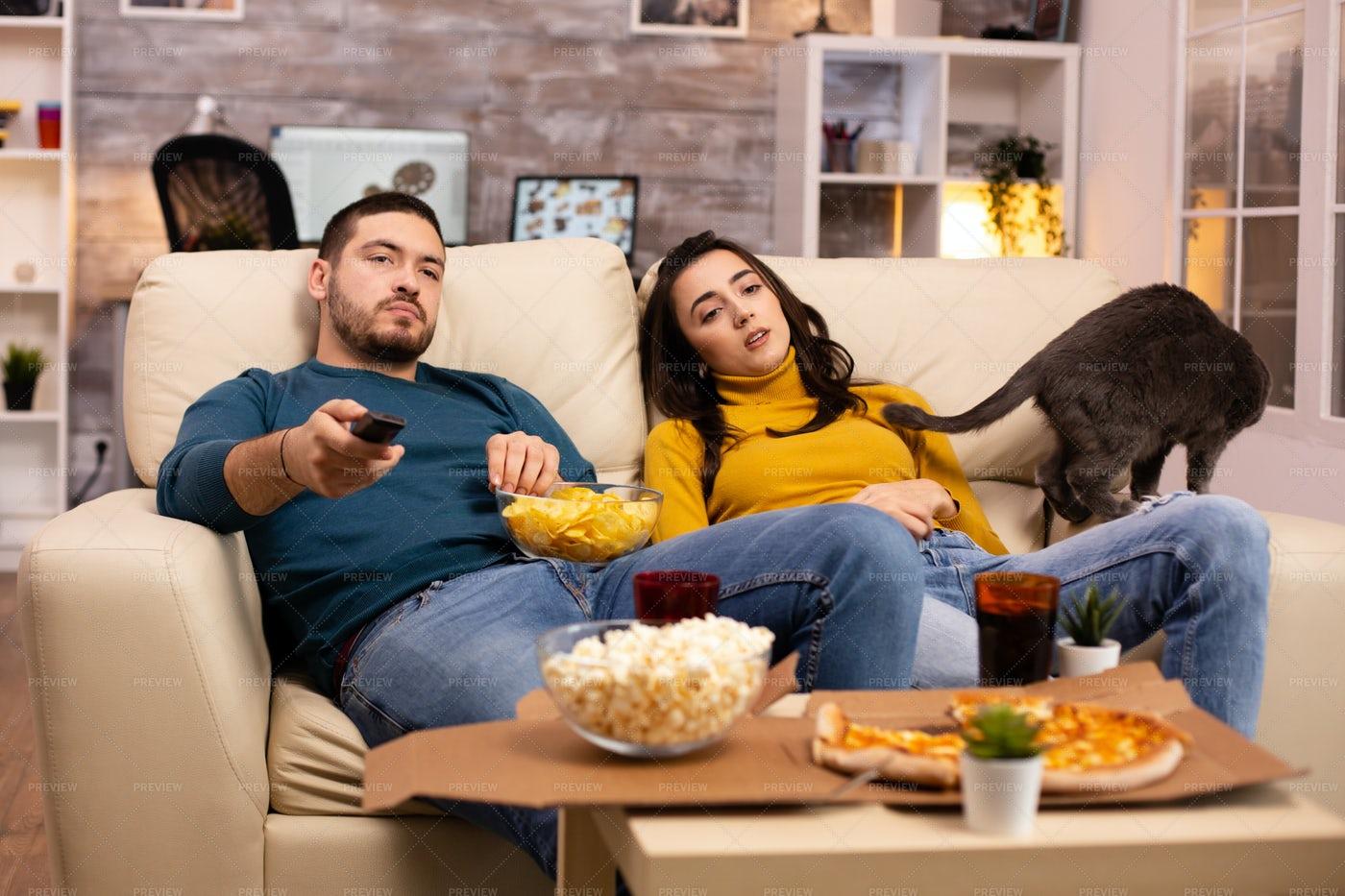 Bored Couple Watching TV: Stock Photos