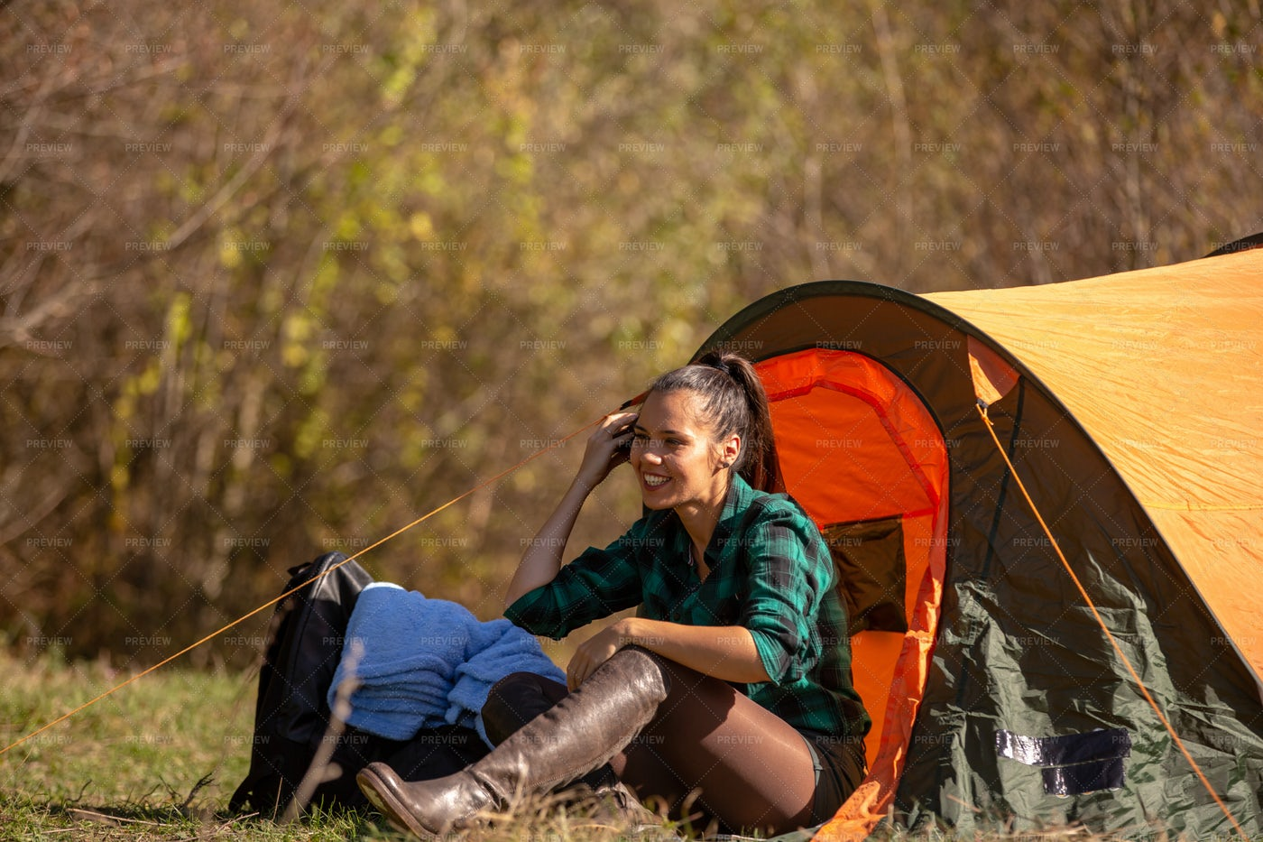 Phone Call By Tent: Stock Photos