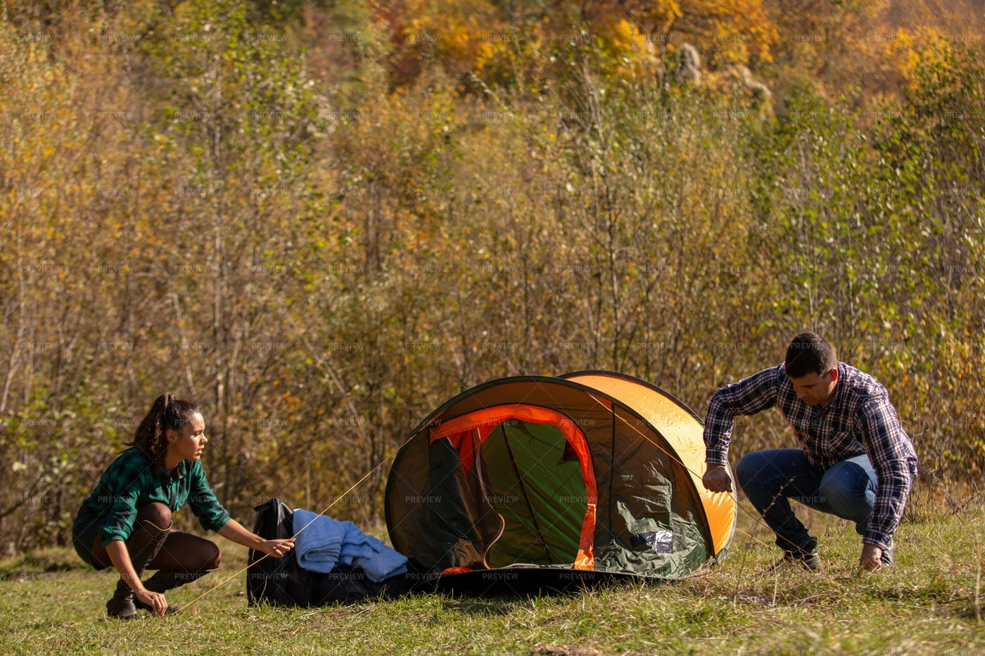 Young Couple Installing Tent: Stock Photos