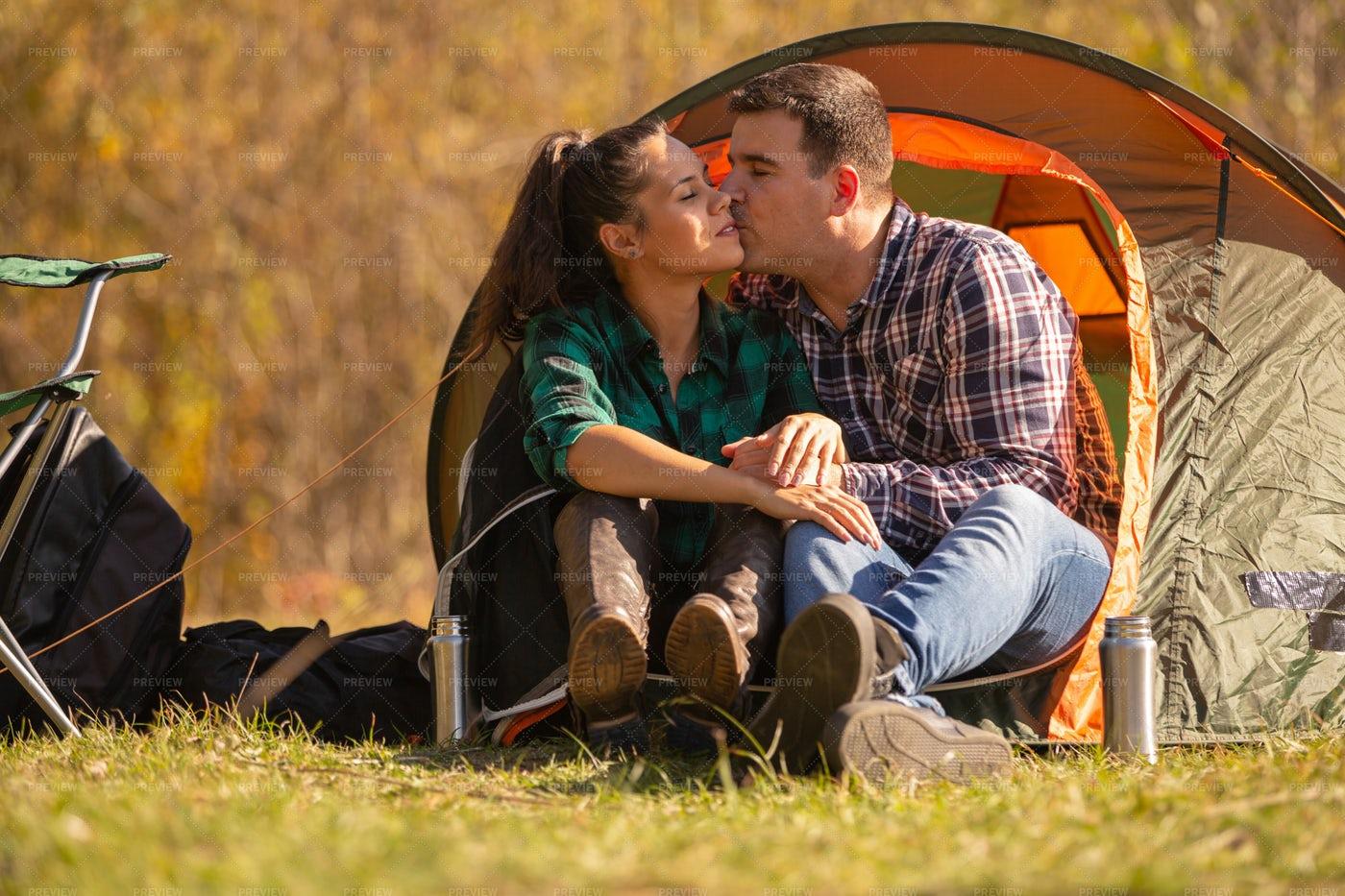 Couple Kissing Outside Tent: Stock Photos