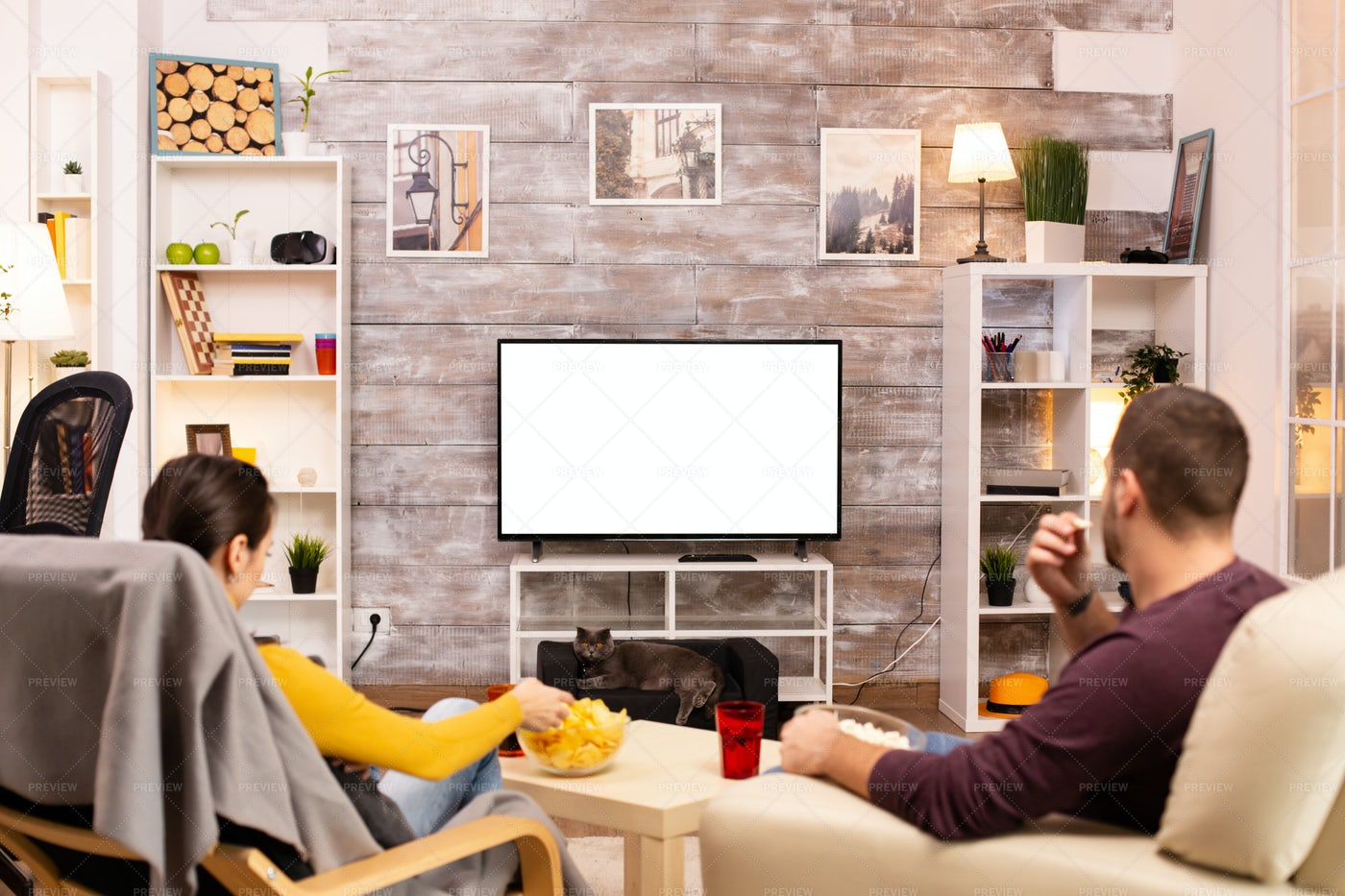 Couple Snacking And Watching TV: Stock Photos