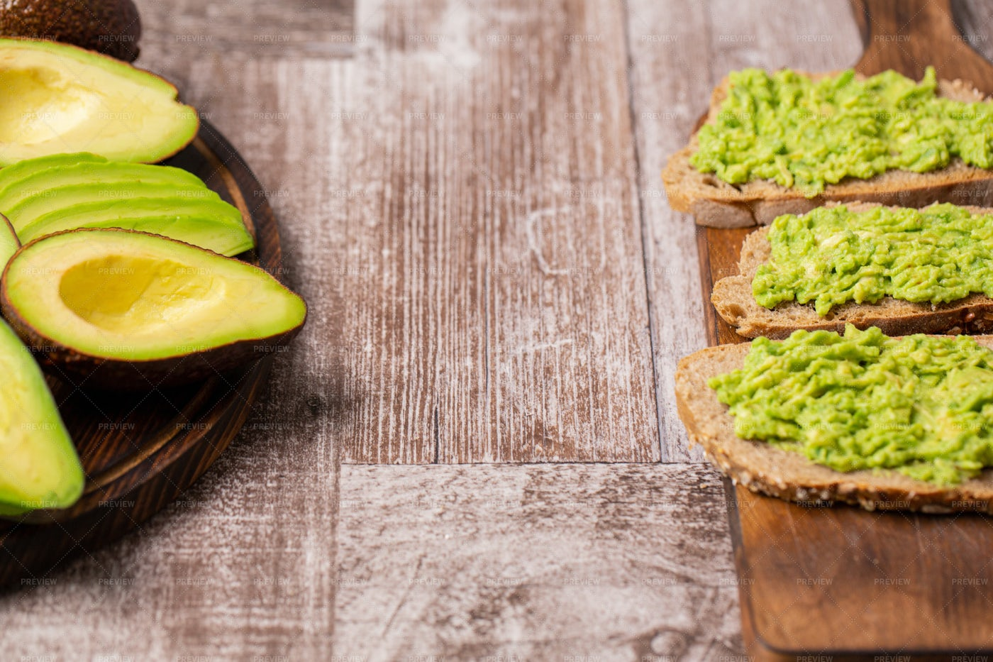Avocado Toast Next To Cutted Ones: Stock Photos