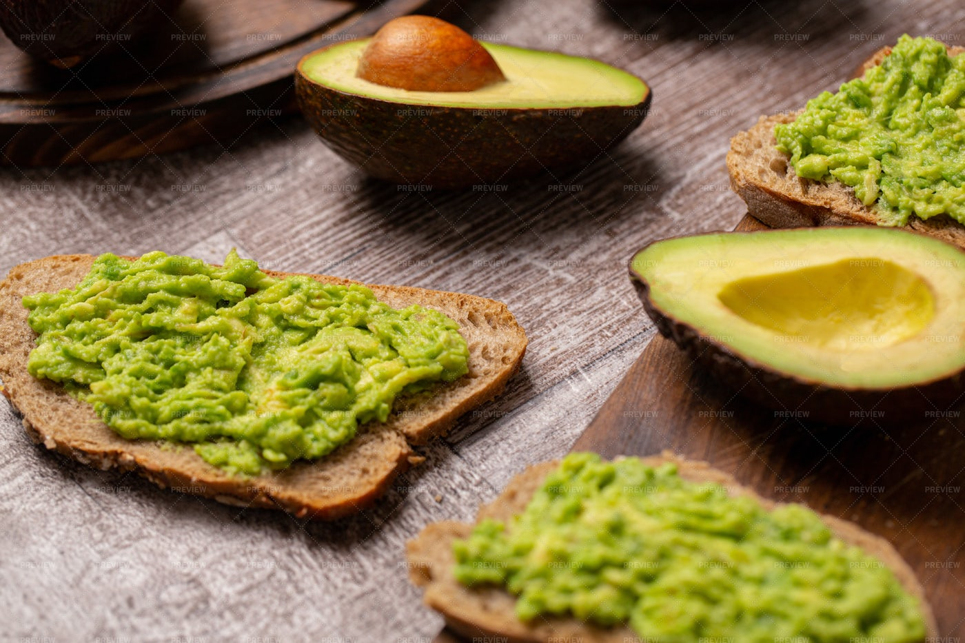 Avocado Sandwiches Next To Cutted Ones: Stock Photos
