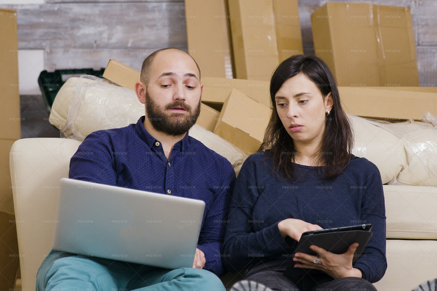 Discussing The Apartment Moving: Stock Photos