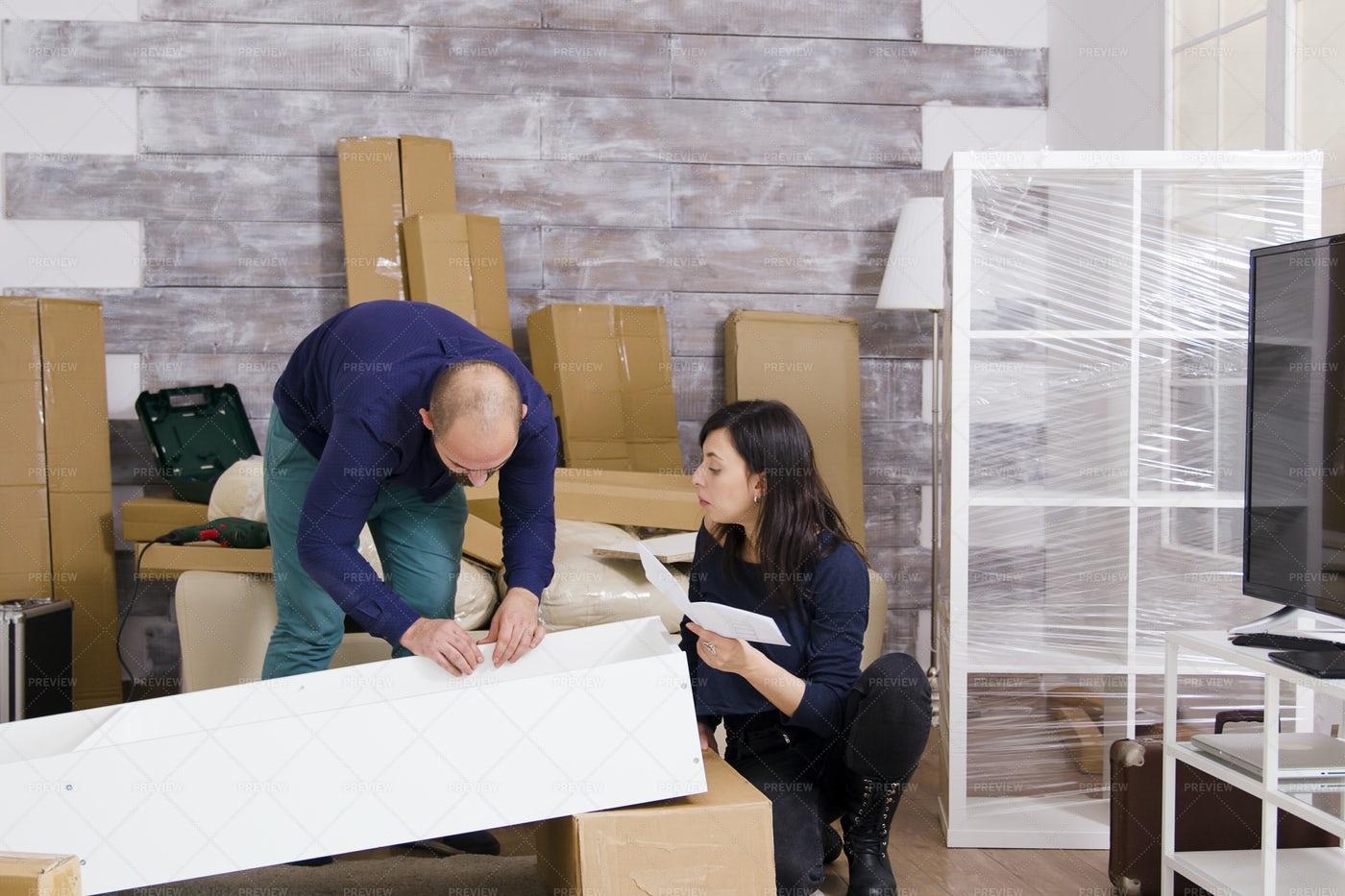 Couple Assembling Furniture: Stock Photos