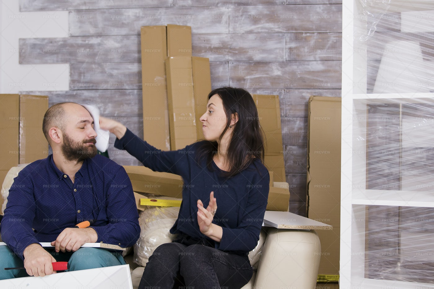 Smacking Partner With Paper: Stock Photos