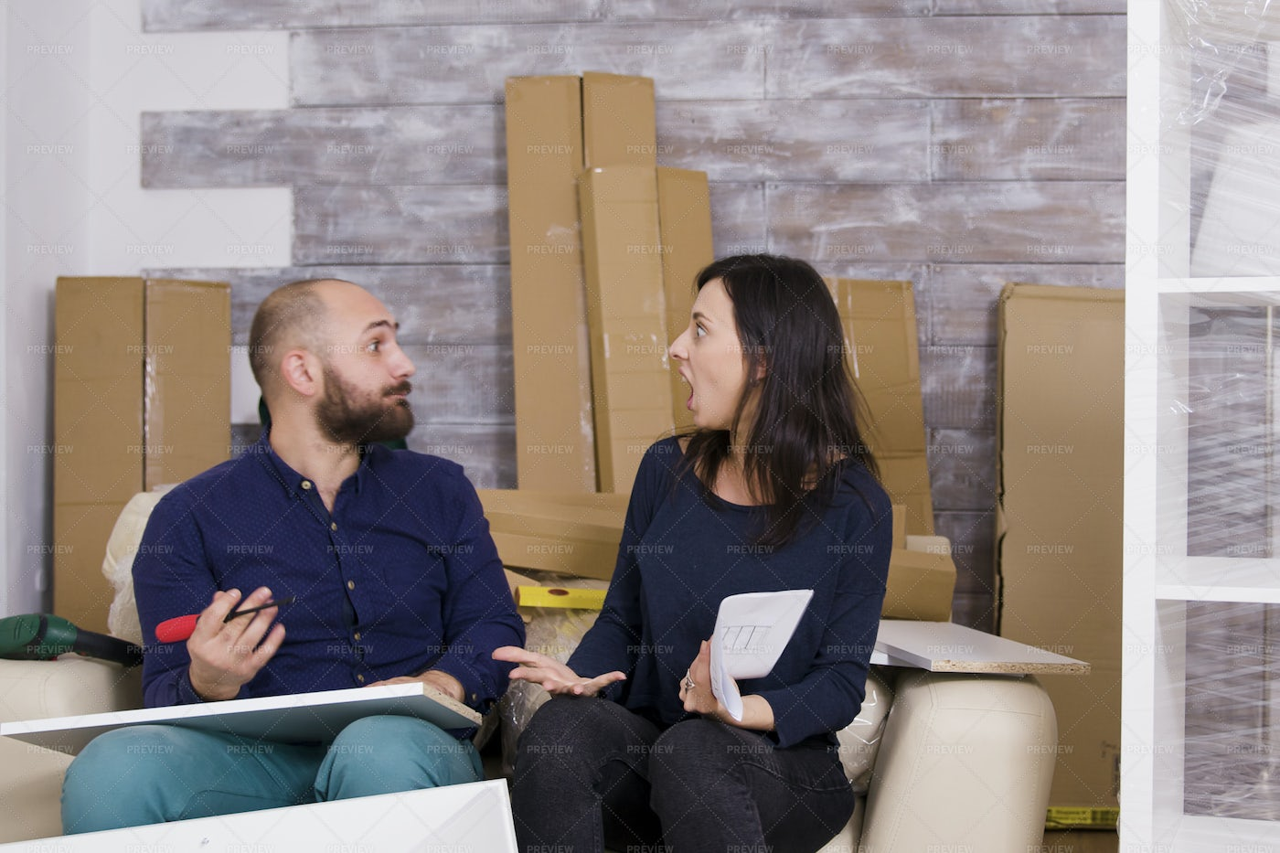 Arguing While Building  Furniture: Stock Photos