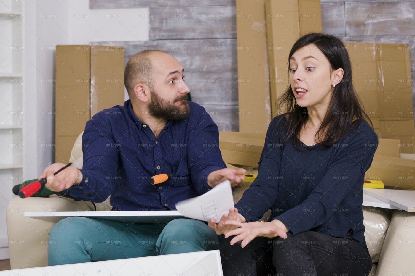Frustrated Couple Building Furniture: Stock Photos