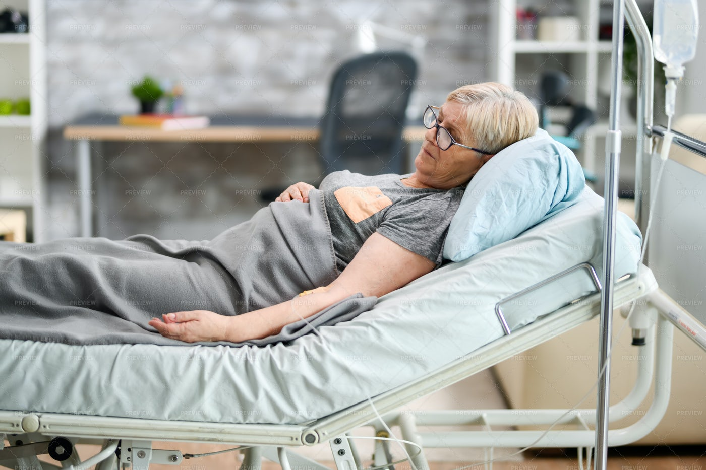 Female In A Nursing Home Bed: Stock Photos