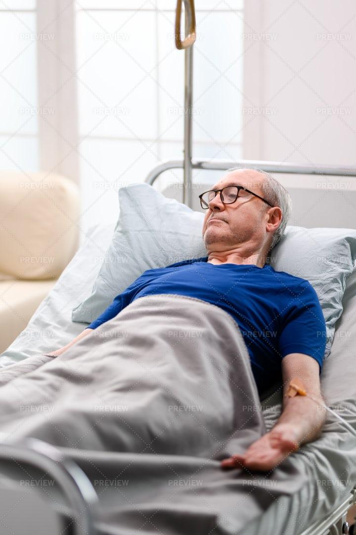 Man In A Nursing Home Bed: Stock Photos