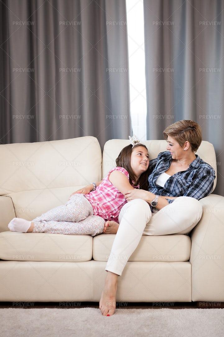 Daughter Cuddling Mother: Stock Photos