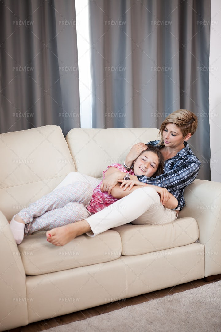 Family Lying On The Couch: Stock Photos