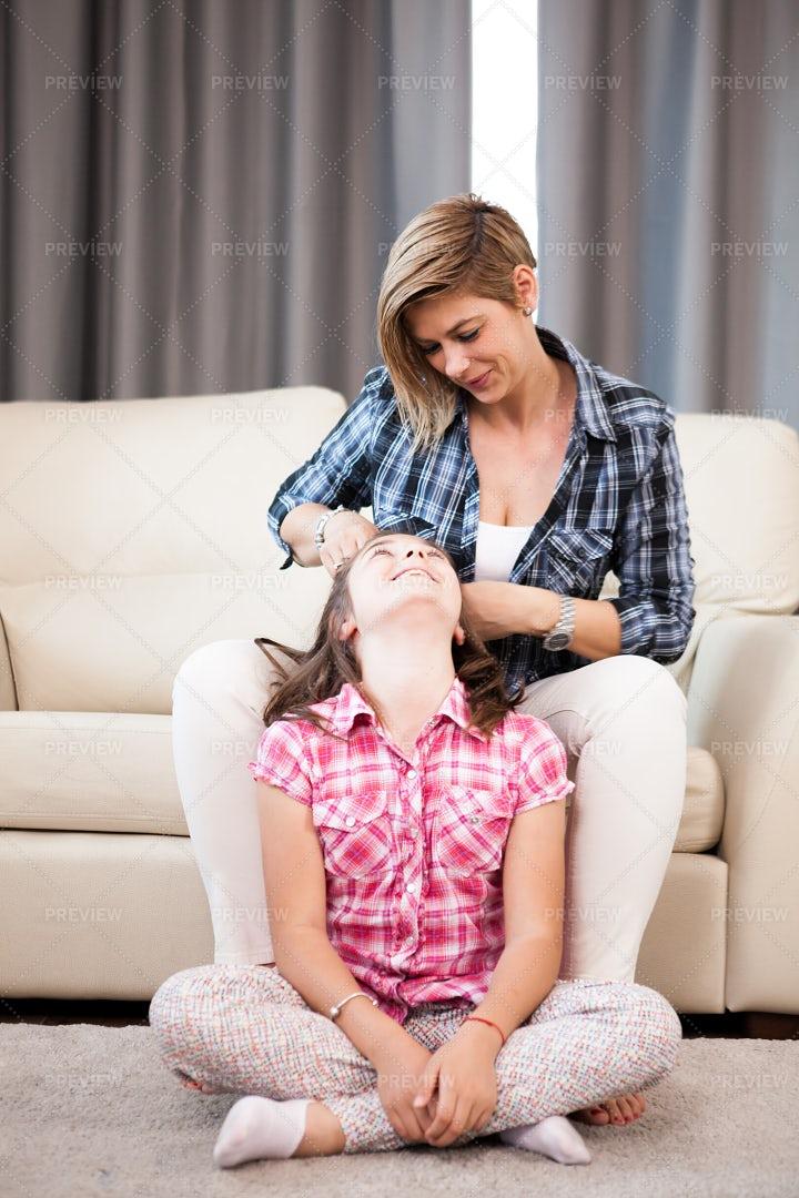 Mom Brushing Daughter's Hair: Stock Photos