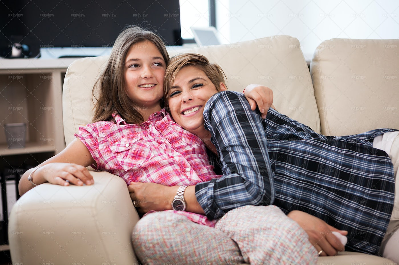 Hugging On The Couch: Stock Photos