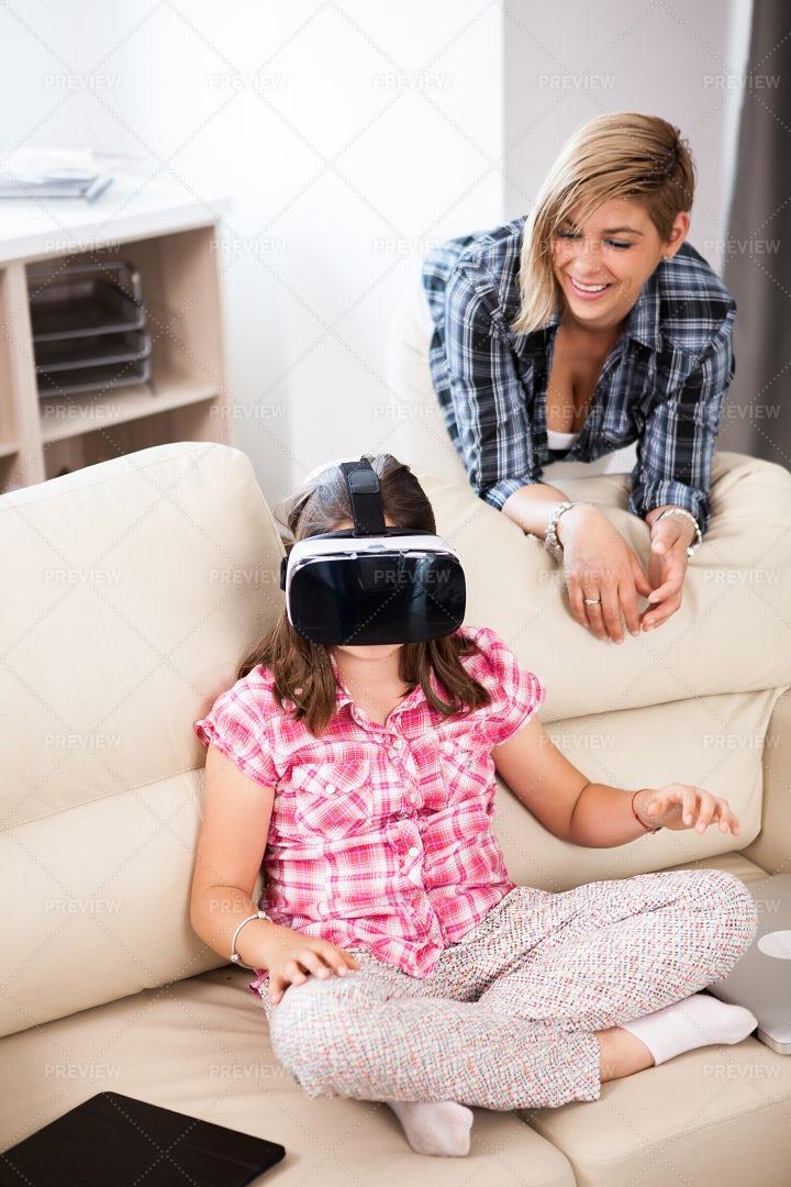 Girl Gaming Using VR: Stock Photos