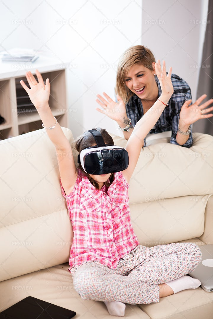 Raising Arms During Virtual Game: Stock Photos