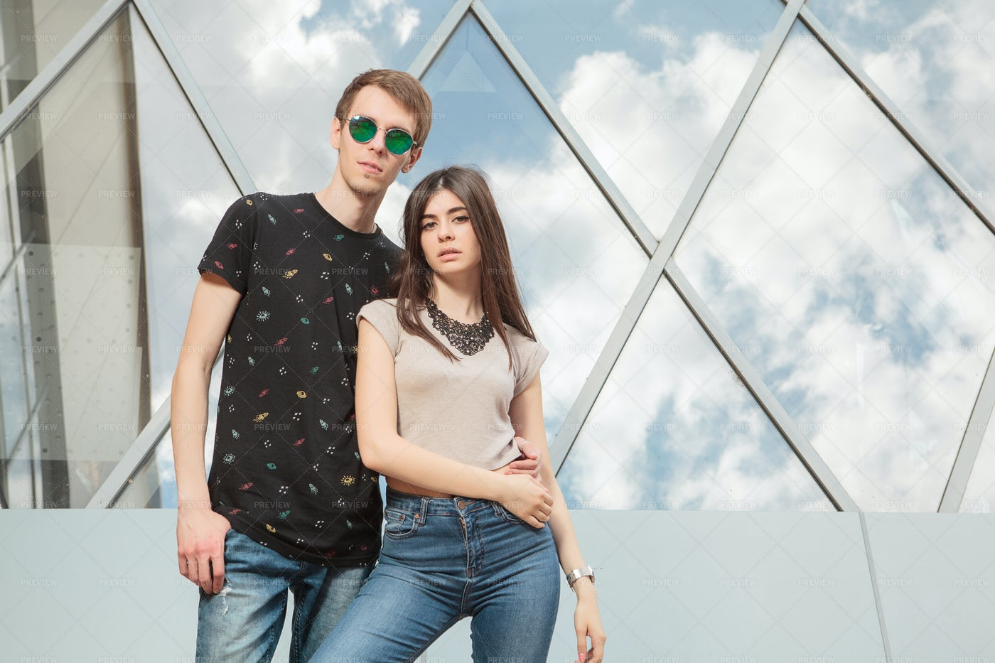 Happy Cool Looking Couple In Jeans: Stock Photos