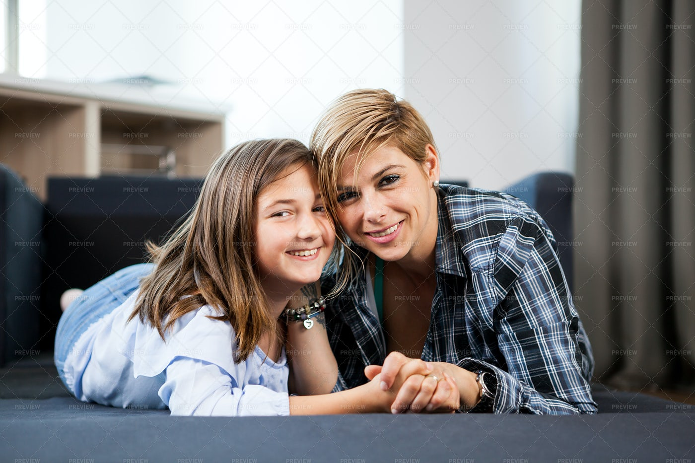A Mother And Daughter Lying Down: Stock Photos