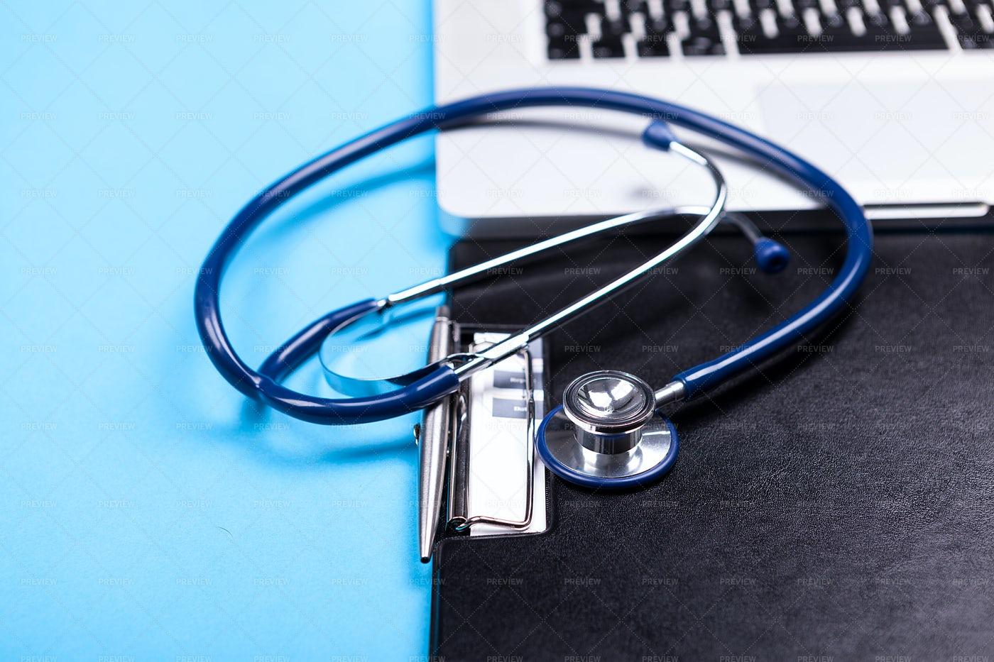 Stethoscope Next To Laptop: Stock Photos