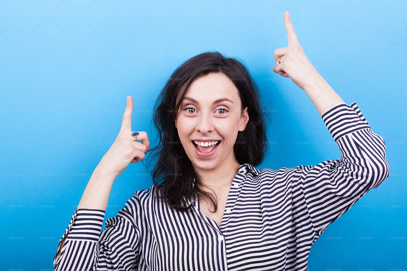 Woman Pointing Up: Stock Photos