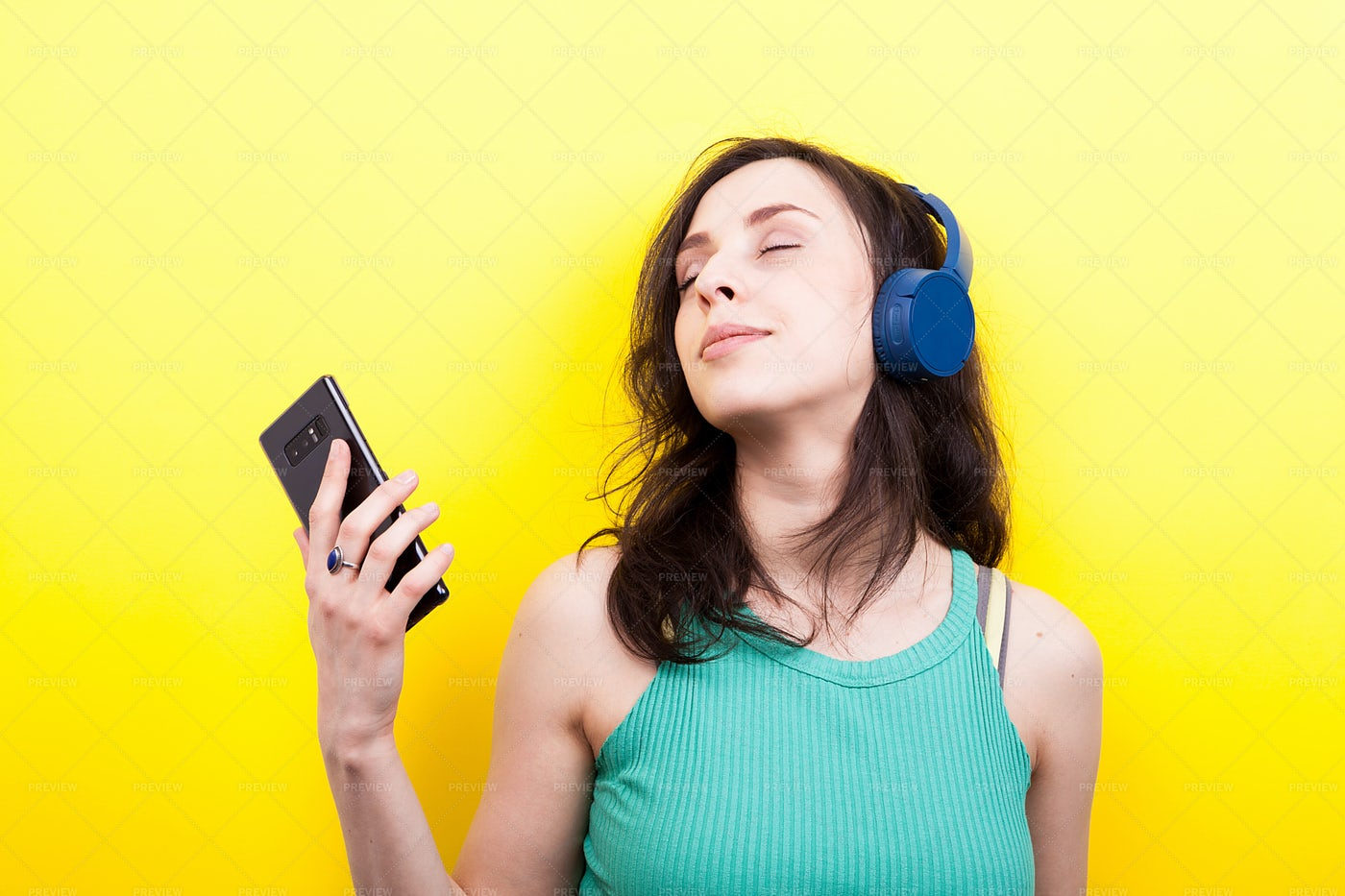 Young Woman Listening To Music: Stock Photos