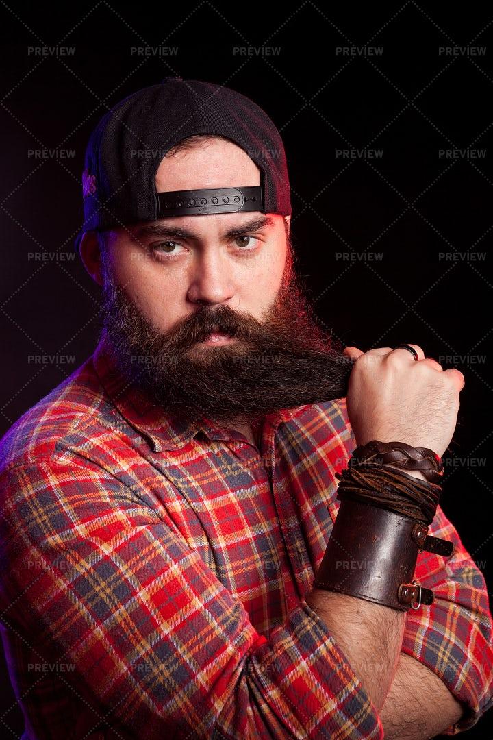 Serious Man With A Cap: Stock Photos
