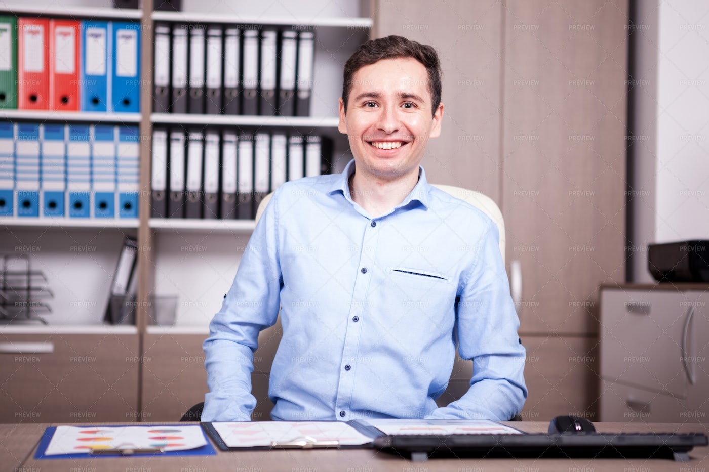 Smiling Businessman In Office: Stock Photos