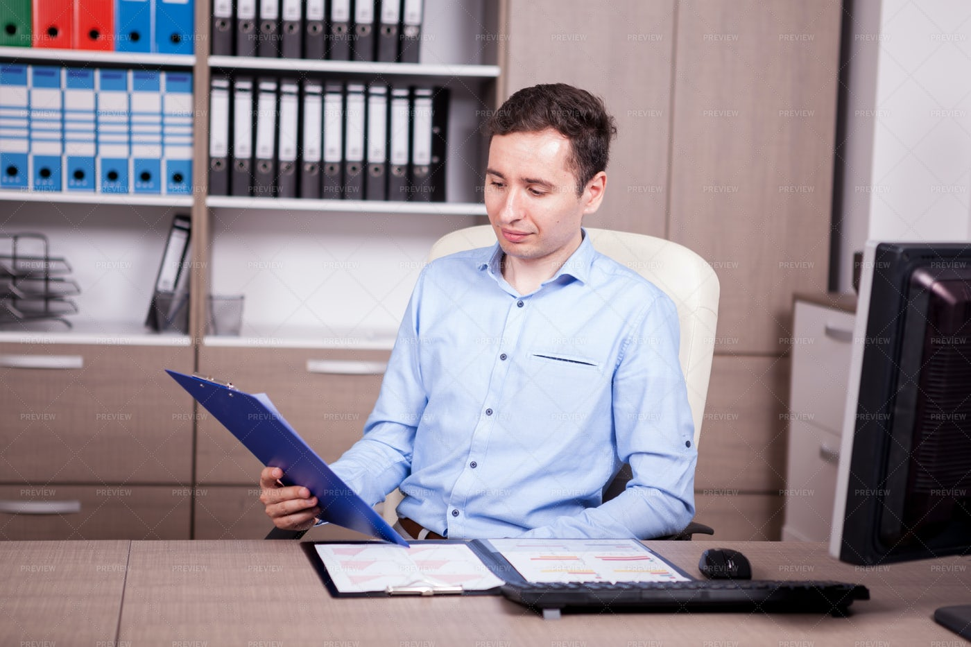 Young Businessman In Office: Stock Photos