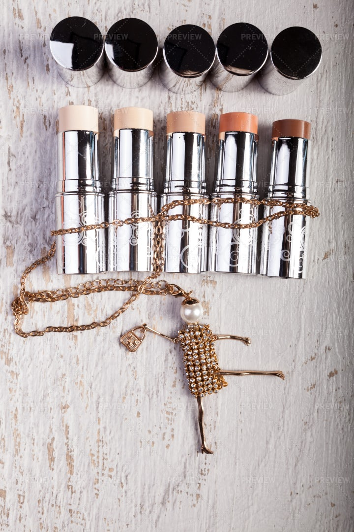 Lipsticks And A Funny Chain: Stock Photos