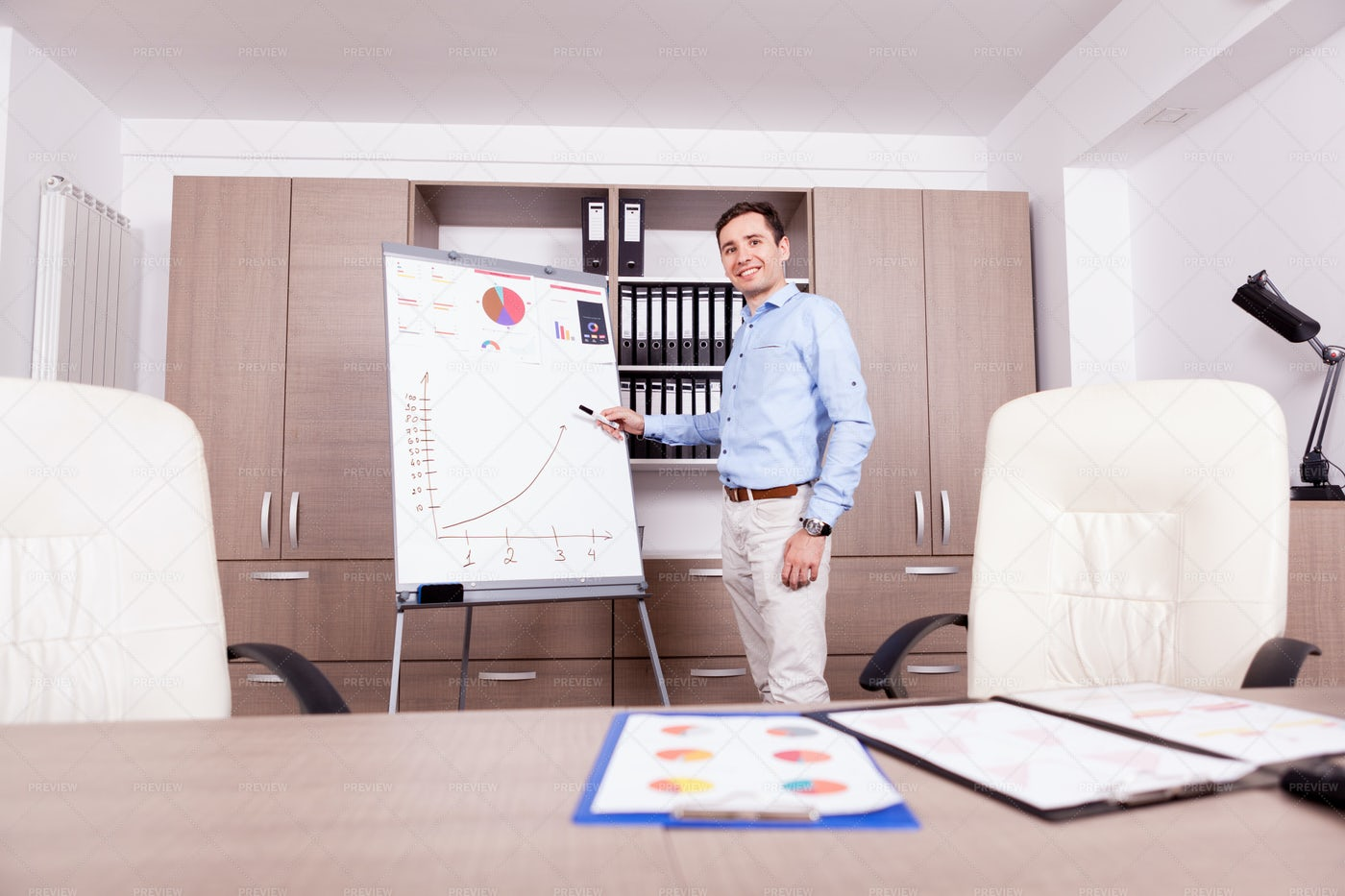 Smiling Businessman With Charts: Stock Photos