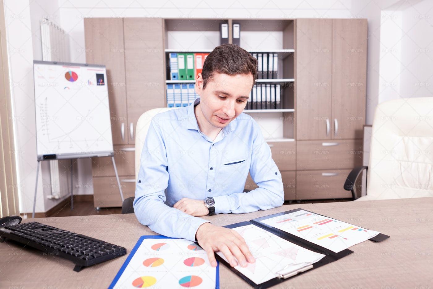 Man Reading Business Charts: Stock Photos