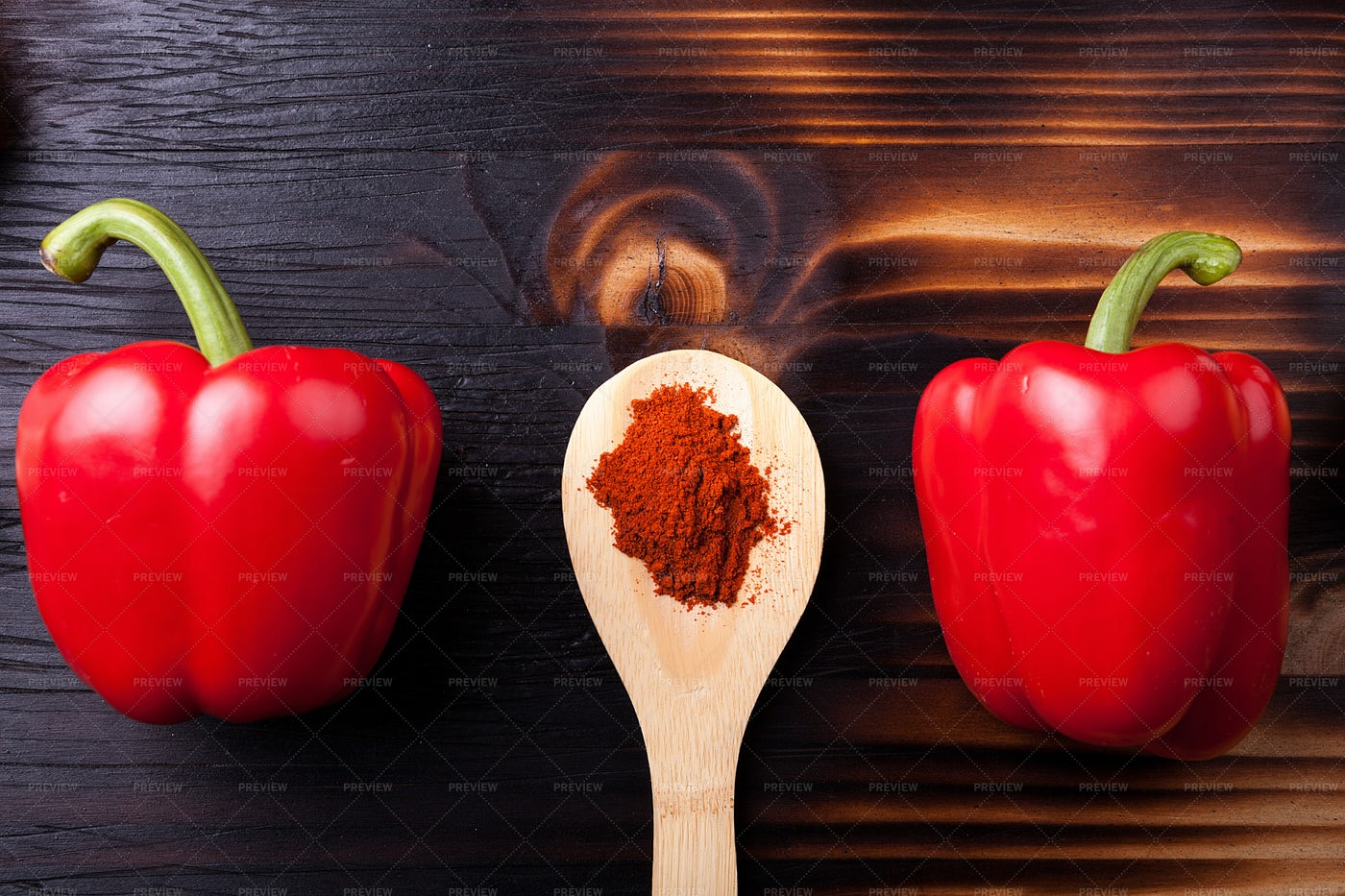 Two Sweet Red Pepper And A Wooden Spoon: Stock Photos