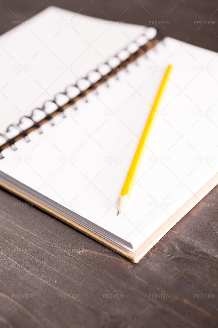Open Notebook With A Pencil In It: Stock Photos