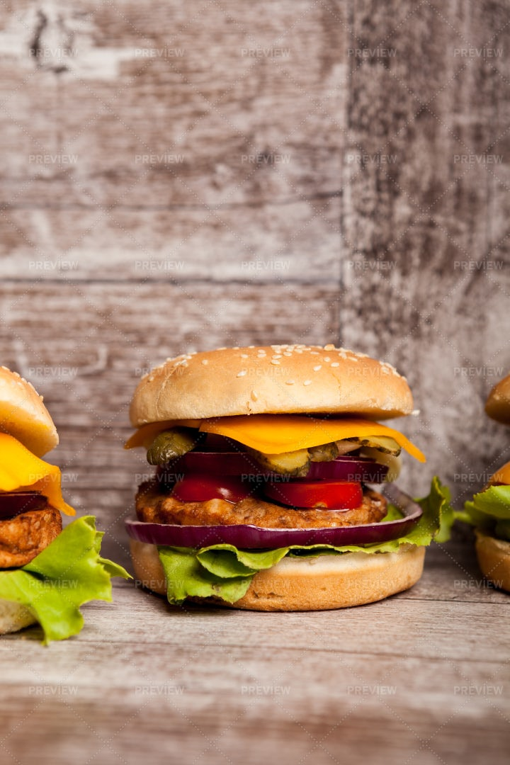 Burgers On Wooden Plate: Stock Photos